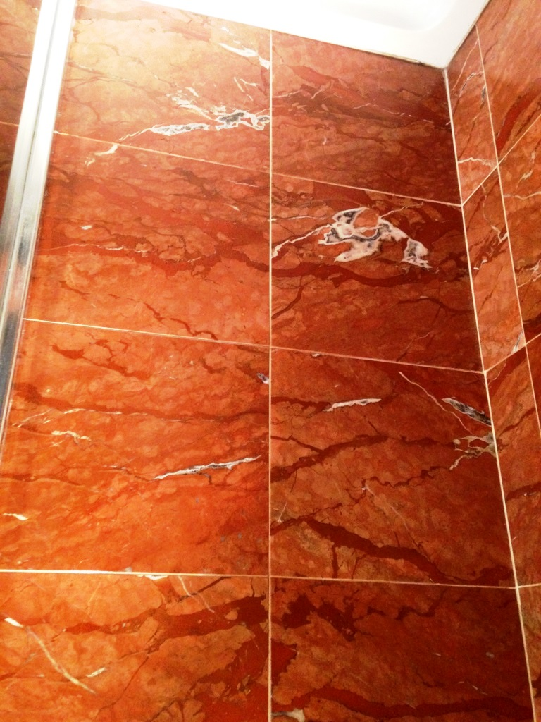 Damaged Marble Shower Tiles in Ringmer After