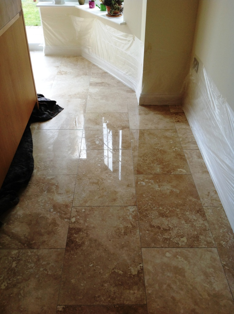 Travertine floor during honing and polishing Polegate