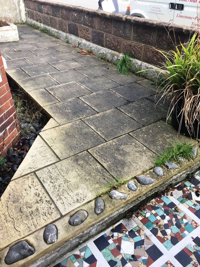 Buff Patio Paving Before Cleaning in Eastbourne